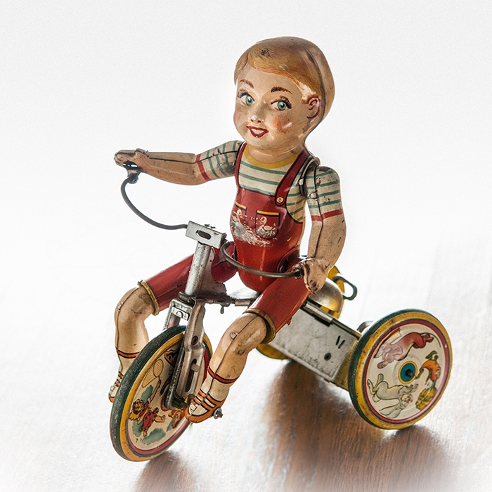 antique vintage mechanical tin toy riding Tricycle